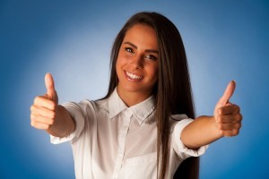 woman giving double thumbs up